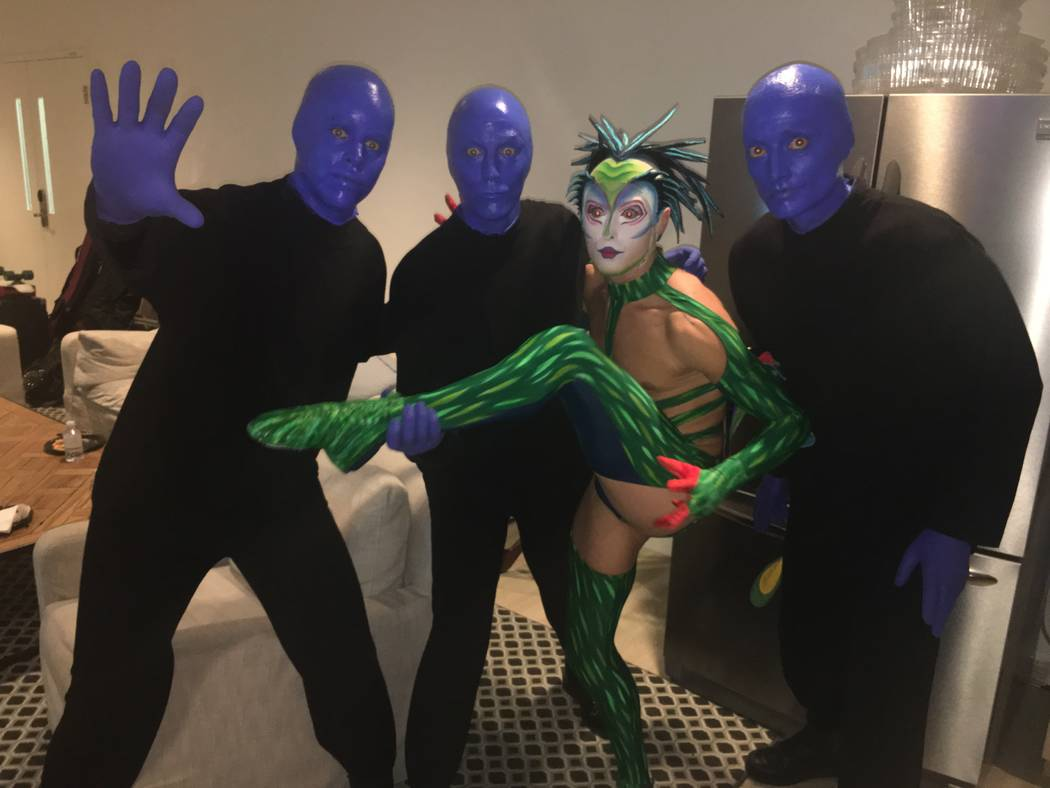 "The cast of Blue Man Group are shown with a Cirque du Soliel ""Mystere"" character backstage at The Venetian Theatre during ""Vegas Cares"" on Sunday, Nov. 5, 2017 (John Katsilometes/Las Vegas Review- ..."