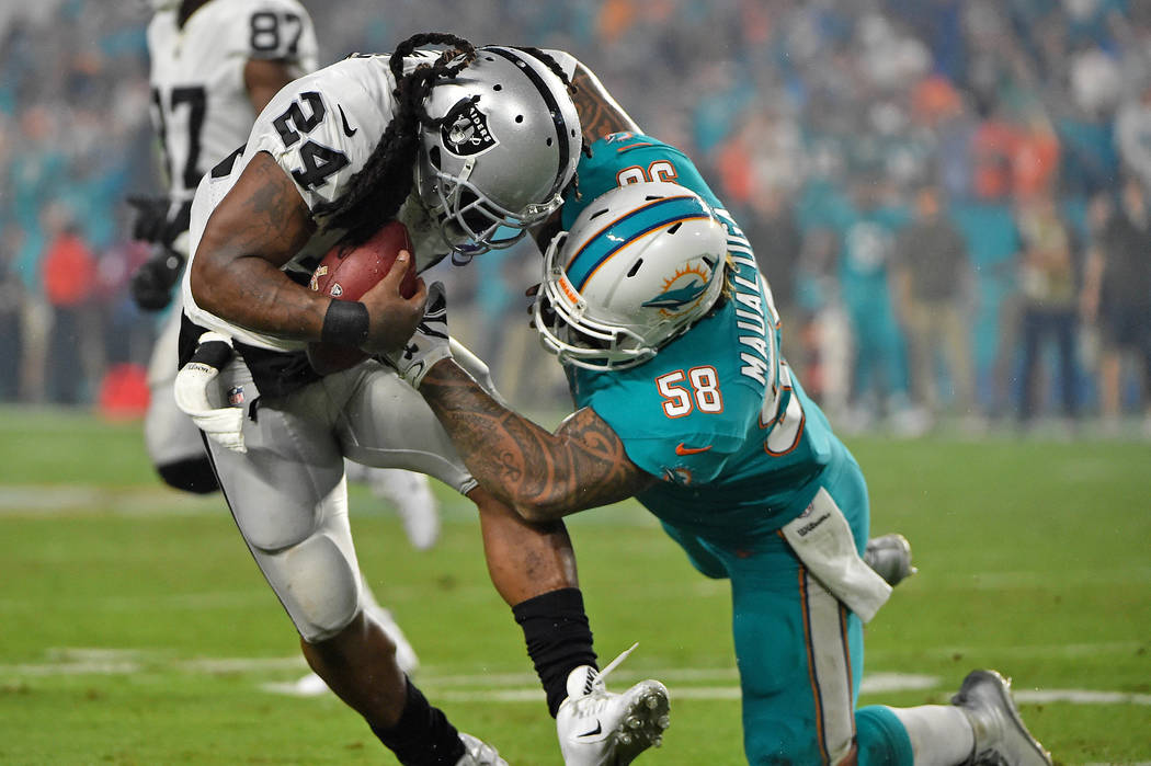 Nov 5, 2017; Miami Gardens, FL, USA; Miami Dolphins outside linebacker Rey Maualuga (58) tackles Oakland Raiders running back Marshawn Lynch (24) during the first half at Hard Rock Stadium. Mandat ...