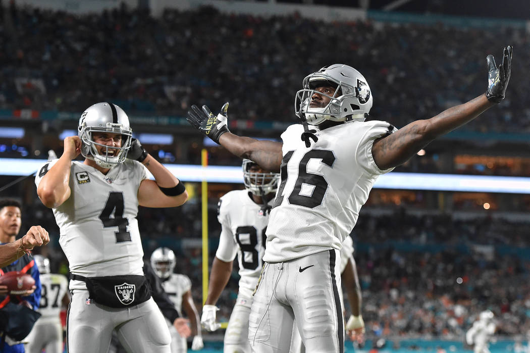 Nov 5, 2017; Miami Gardens, FL, USA; Oakland Raiders wide receiver Johnny Holton (16) celebrates his touchdown against the Miami Dolphins during the first half at Hard Rock Stadium. Mandatory Cred ...