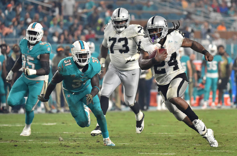 Nov 5, 2017; Miami Gardens, FL, USA; Oakland Raiders running back Marshawn Lynch (24) runs past Miami Dolphins free safety Michael Thomas (31) for a touchdown during the second half at Hard Rock S ...