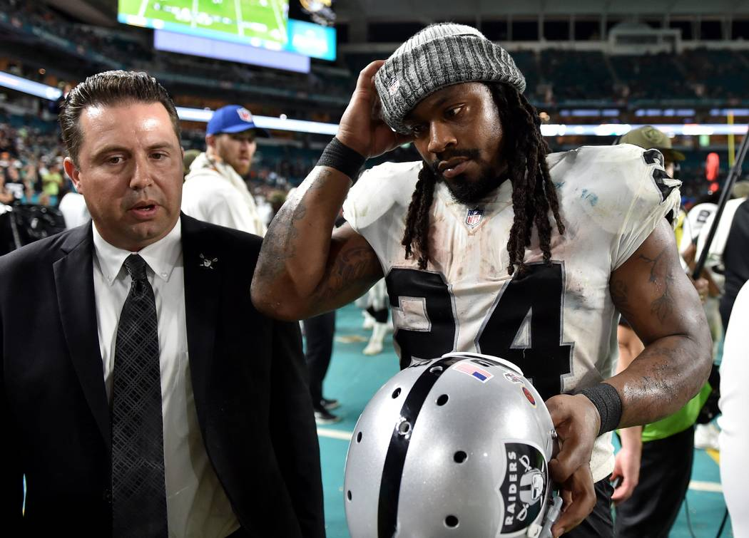 Nov 5, 2017; Miami Gardens, FL, USA; Oakland Raiders running back Marshawn Lynch (24) leaves the game during the second half against the Miami Dolphins at Hard Rock Stadium. Mandatory Credit: Stev ...