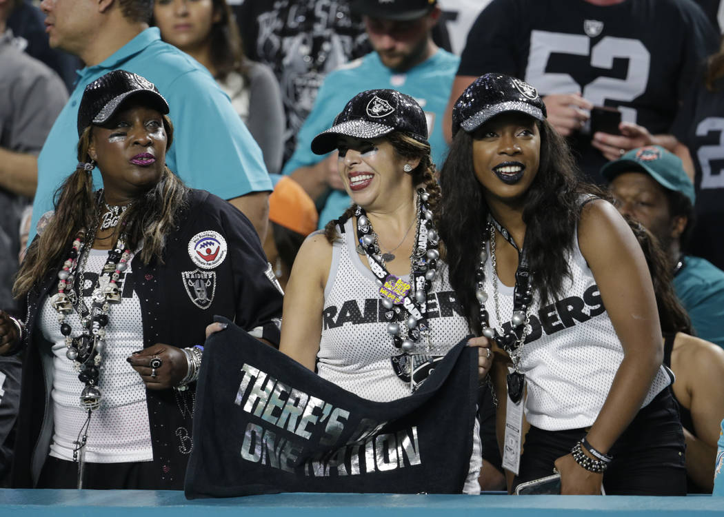 Oakland Raiders fans cheer the team, during the first half of an NFL football game against the Miami Dolphins, Sunday, Nov. 5, 2017, in Miami Gardens, Fla. (AP Photo/Lynne Sladky)