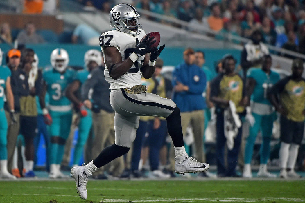 Nov 5, 2017; Miami Gardens, FL, USA; Oakland Raiders tight end Jared Cook (87) makes a catch against the Miami Dolphins during the first half at Hard Rock Stadium. (Jasen Vinlove-USA TODAY Sports)