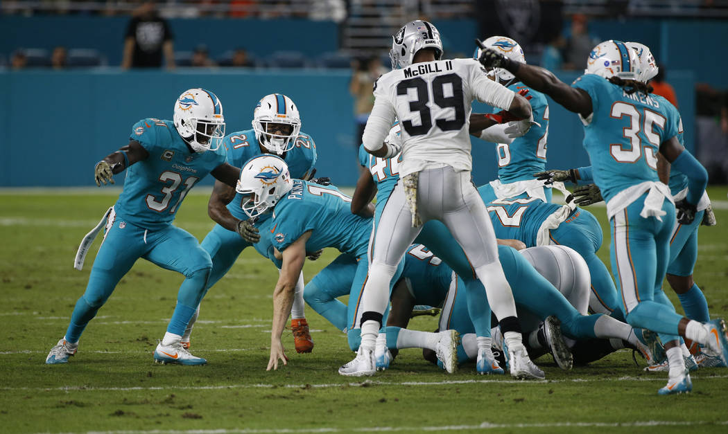 Miami Dolphins kicker Cody Parkey (1) recovers his own onside kick, during the first half of an NFL football game against the Oakland Raiders, Sunday, Nov. 5, 2017, in Miami Gardens, Fla. (AP Phot ...