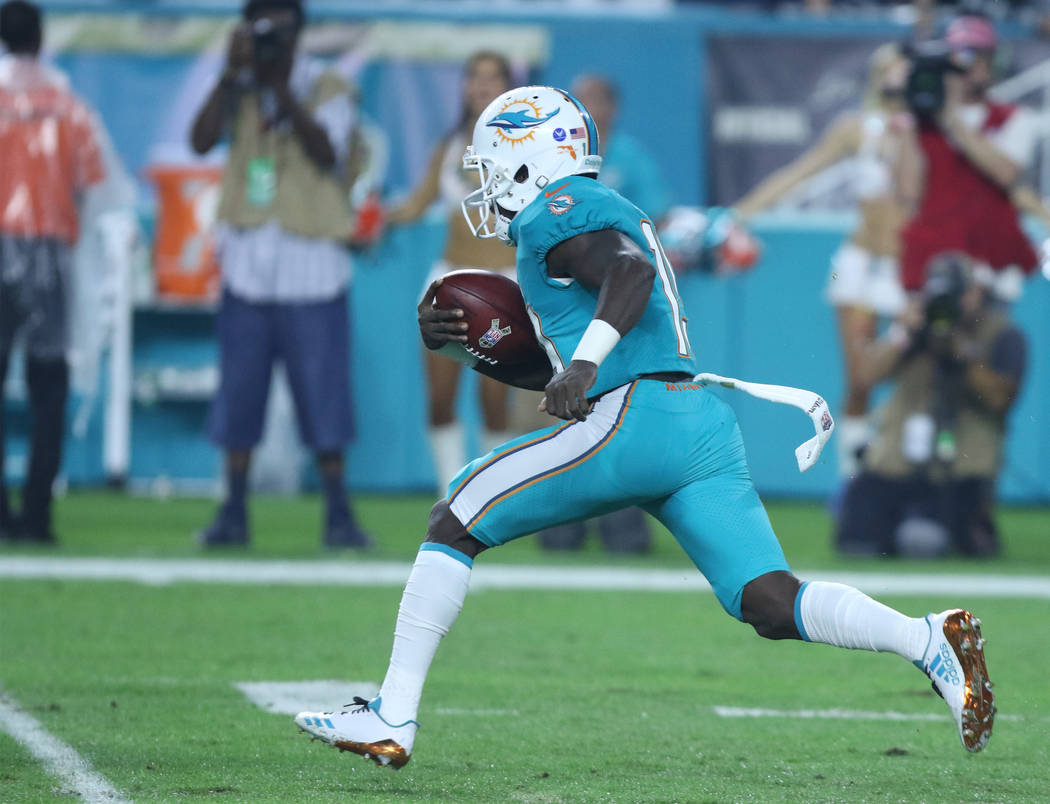 Miami Dolphins wide receiver Jakeem Grant (19) runs with the football on a kickoff return during the first half of the NFL game against the Oakland Raiders in Miami Gardens, Fla., Sunday, Nov. 5,  ...