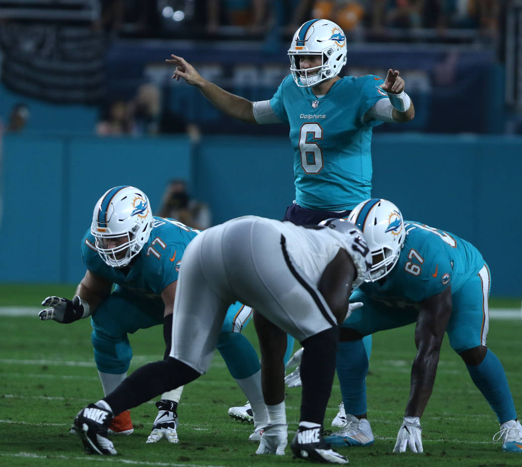 Miami Dolphins quarterback Jay Cutler (6) on the line of scrimmage during the first half of the NFL game against the Oakland Raiders in Miami Gardens, Fla., Sunday, Nov. 5, 2017. Heidi Fang Las Ve ...