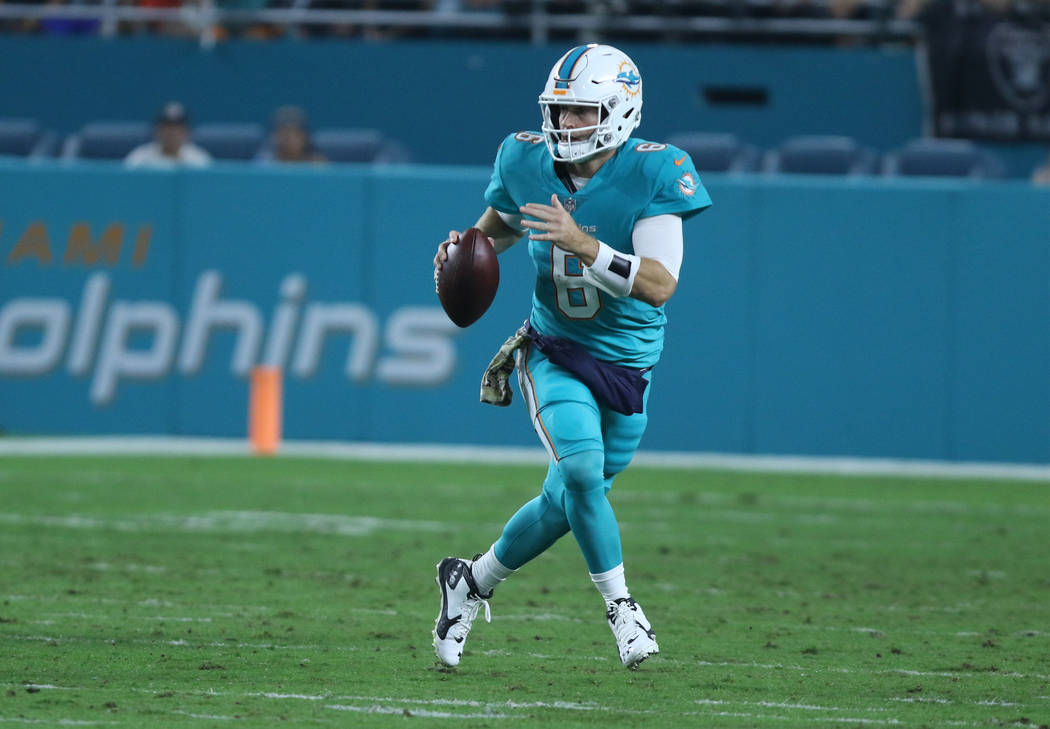 Miami Dolphins quarterback Jay Cutler (6) runs with the football during the first half of the NFL game against the Oakland Raiders in Miami Gardens, Fla., Sunday, Nov. 5, 2017. Heidi Fang Las Vega ...