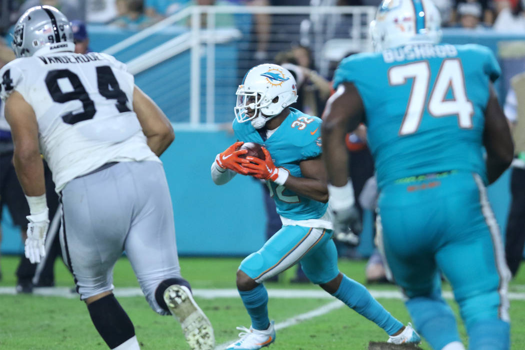 Miami Dolphins running back Kenyan Drake (32) runs with the football during the first half of the NFL game in Miami Gardens, Fla., Sunday, Nov. 5, 2017. Heidi Fang Las Vegas Review-Journal @HeidiFang