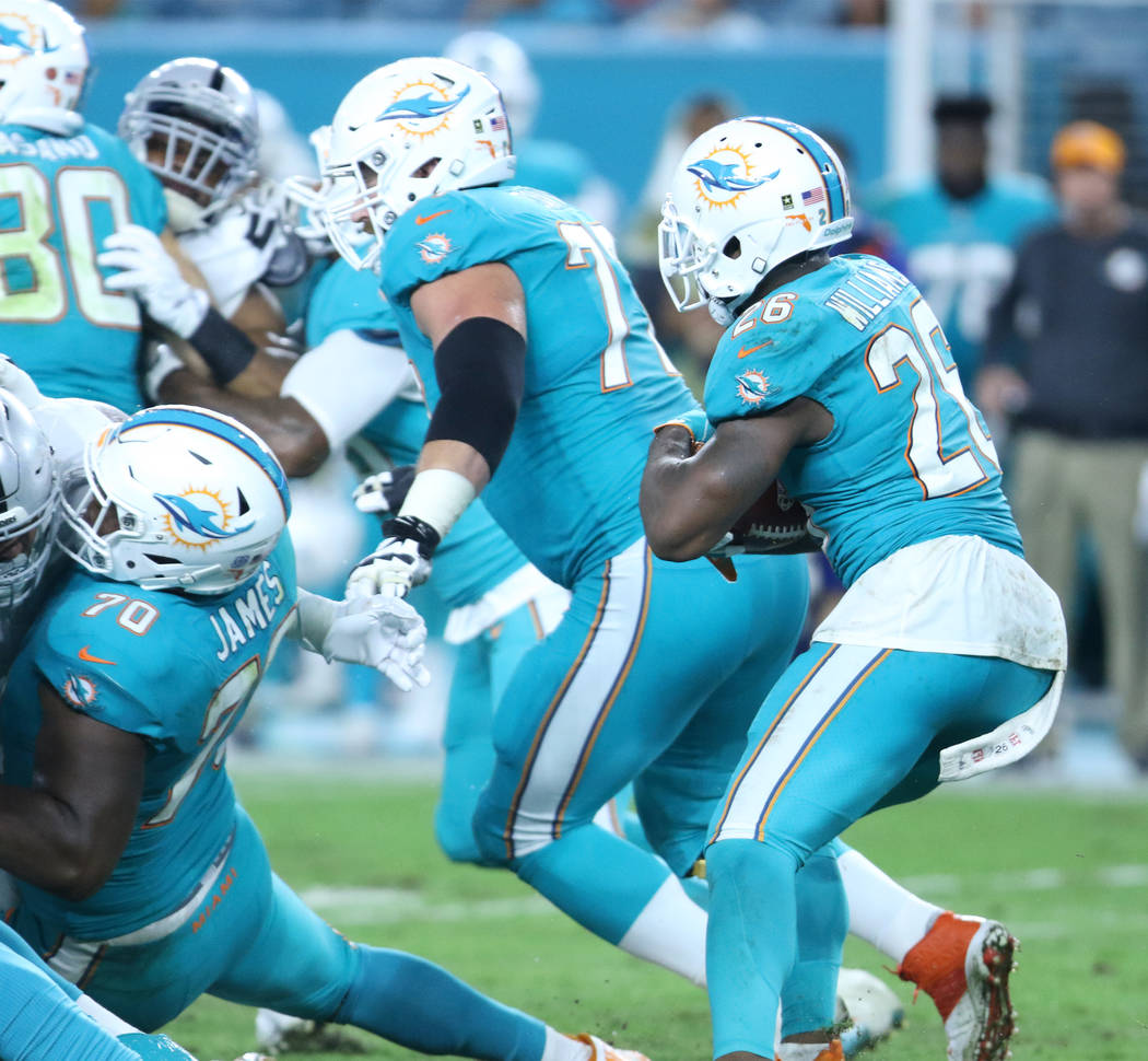 Miami Dolphins running back Damien Williams (26) runs with the football during the first half of the NFL game in Miami Gardens, Fla., Sunday, Nov. 5, 2017. Heidi Fang Las Vegas Review-Journal @Hei ...