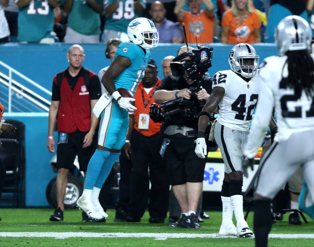 Miami Dolphins wide receiver DeVante Parker (11) celebrates a big catch during the first half of the NFL game against the Oakland Raiders in Miami Gardens, Fla., Sunday, Nov. 5, 2017. Heidi Fang L ...