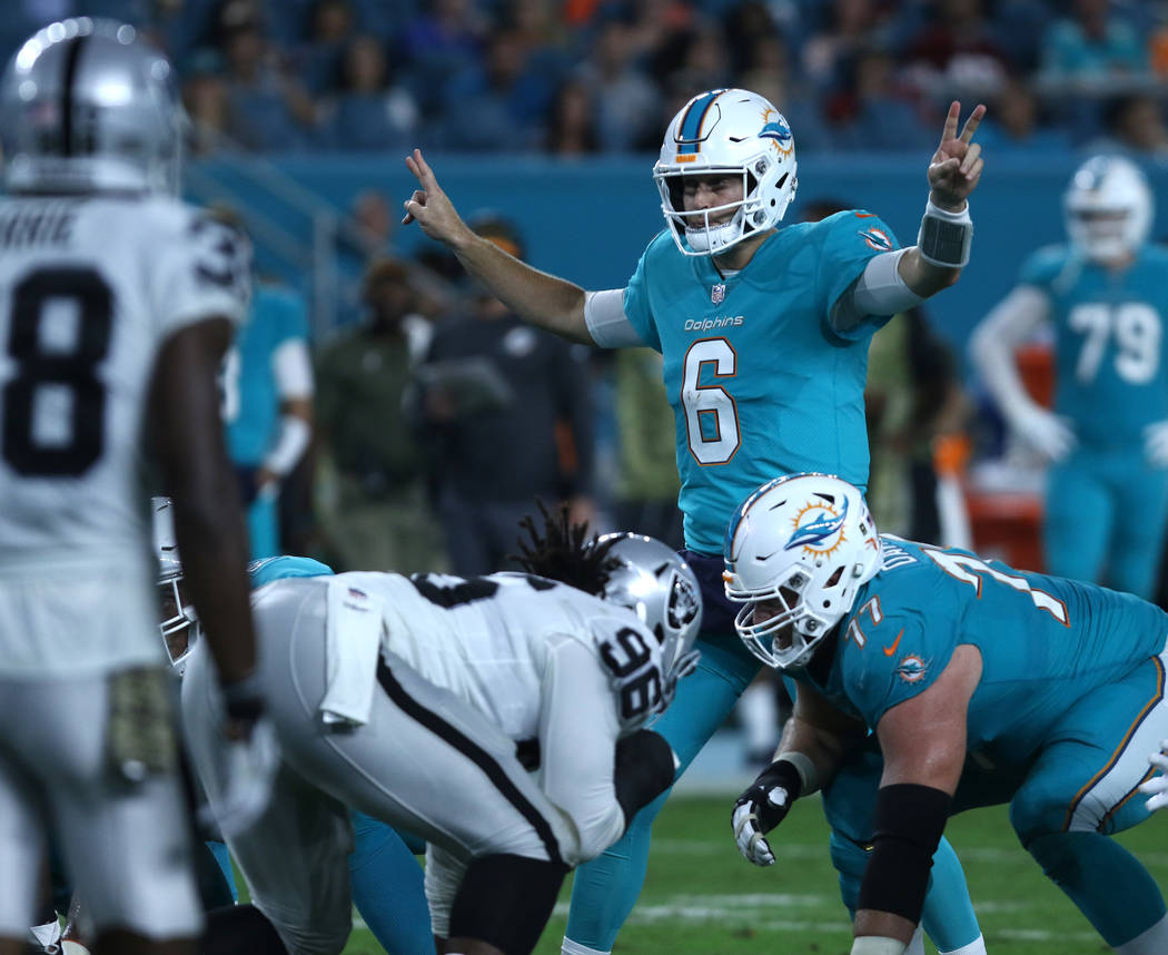 Miami Dolphins quarterback Jay Cutler (6) at the line of scrimmage during the first half of the NFL game against the Oakland Raiders in Miami Gardens, Fla., Sunday, Nov. 5, 2017. Heidi Fang Las Ve ...