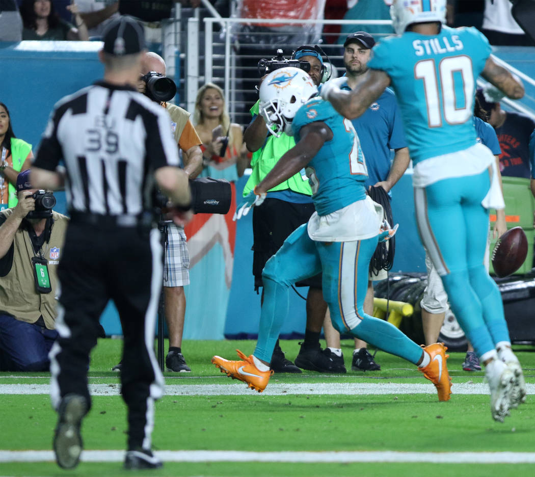 Miami Dolphins running back Damien Williams (26) scores during the first half of the NFL game against the Oakland Raiders in Miami Gardens, Fla., Sunday, Nov. 5, 2017. Heidi Fang Las Vegas Review- ...