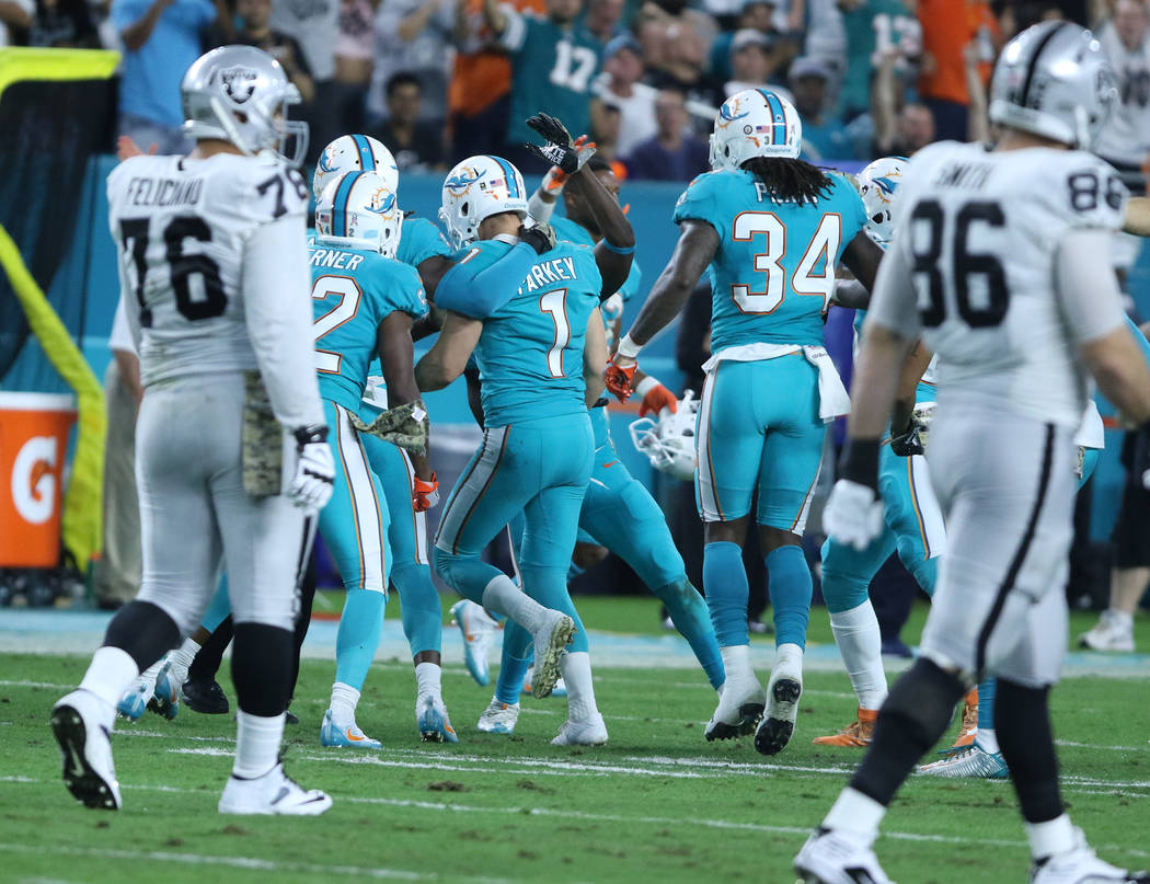Miami Dolphins kicker Cody Parkey (1) recovers his own onside kick during the first half of the NFL game against the Oakland Raiders in Miami Gardens, Fla., Sunday, Nov. 5, 2017. Heidi Fang Las Ve ...