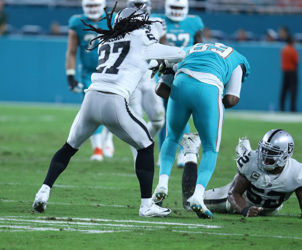 Oakland Raiders free safety Reggie Nelson (27) tries to tackle Miami Dolphins tight end Julius Thomas (89) during the first half of the NFL game in Miami Gardens, Fla., Sunday, Nov. 5, 2017. Heidi ...