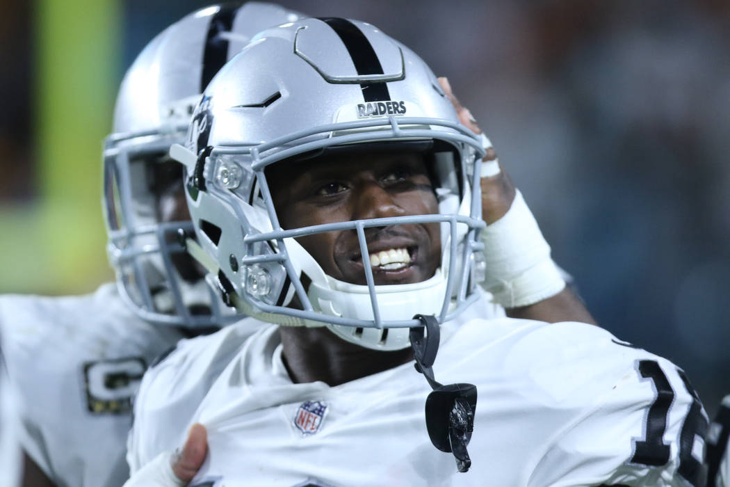 Oakland Raiders wide receiver Johnny Holton (16) smiles after scoring a touchdown during the first half of the NFL game against the Miami Dolphins in Miami Gardens, Fla., Sunday, Nov. 5, 2017. Hei ...