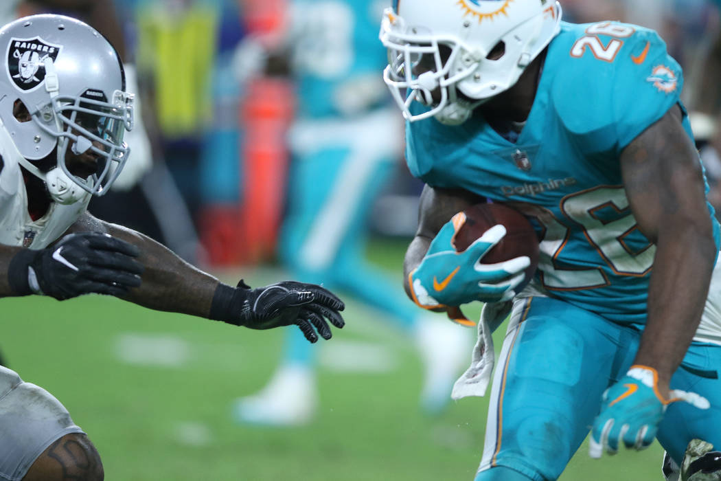 Oakland Raiders middle linebacker NaVorro Bowman (53) comes in to tackle Miami Dolphins running back Damien Williams (26) during the first half of the NFL game in Miami Gardens, Fla., Sunday, Nov. ...