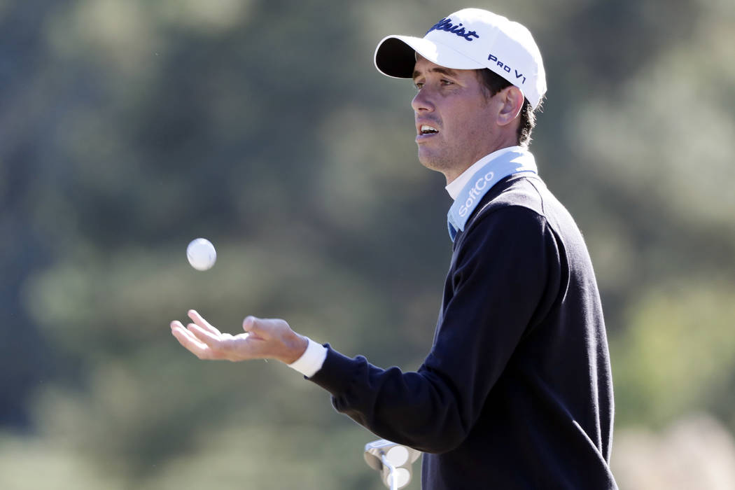 Chesson Hadley catches a cleaned ball from his caddie on the 17th hole during the third round of the Sanderson Farms Championship golf tournament in Jackson, Miss., Saturday, Oct. 28, 2017. (AP Ph ...