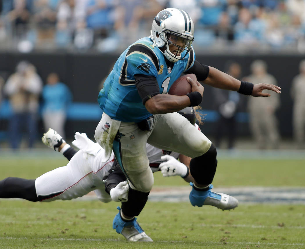 Carolina Panthers' Cam Newton (1) runs against the Atlanta Falcons in the second half of an NFL football game in Charlotte, N.C., Sunday, Nov. 5, 2017. (AP Photo/Bob Leverone)