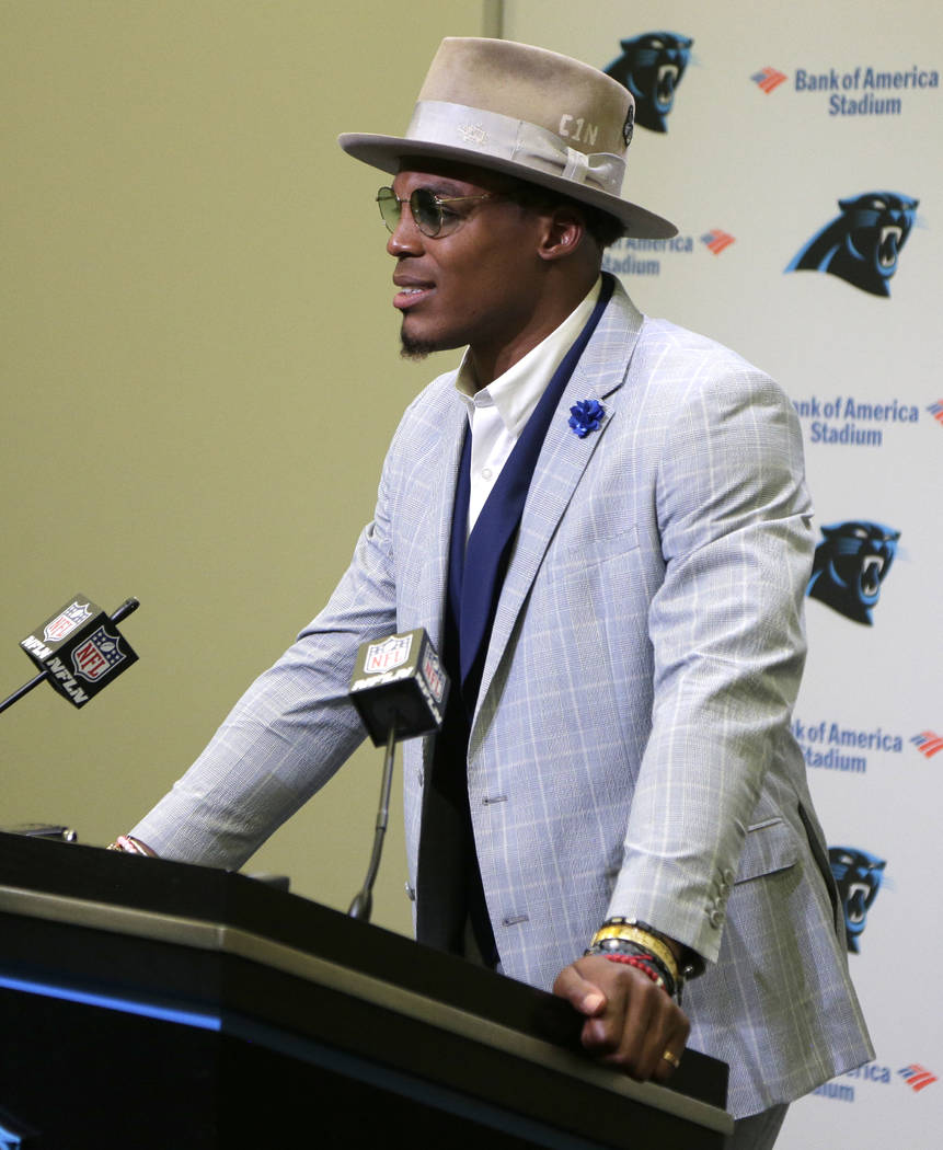 Carolina Panthers' Cam Newton speaks to the media after an NFL football game against the Atlanta Falcons in Charlotte, N.C., Sunday, Nov. 5, 2017. (AP Photo/Chuck Burton)