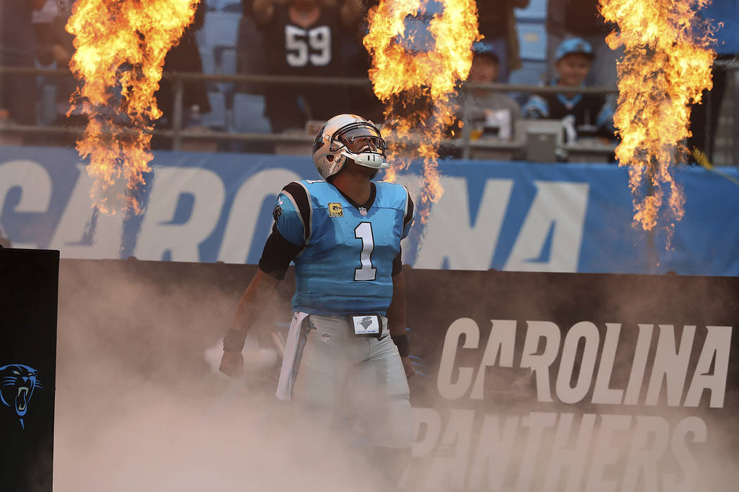 Carolina Panthers quarterback Cam Newton takes the field on the way to beating the Atlanta Falcons 20-17 in a NFL football game on Sunday, Nov. 5, 2017, in Charlotte. (Curtis Compton/Atlanta Journ ...