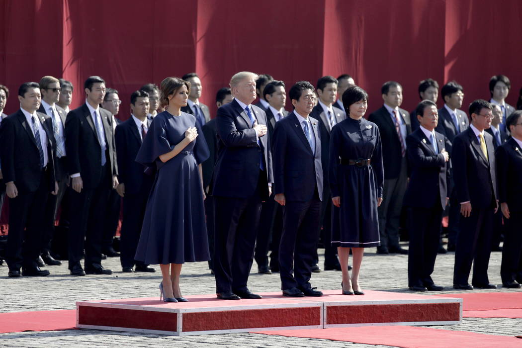 First Lady Melania Trump, from front left to right, U.S. President Donald Trump, Japanese Prime Minister Shinzo Abe, and his wife Akie Abe observe an honor guard at Akasaka Palace in Tokyo, Japan, ...