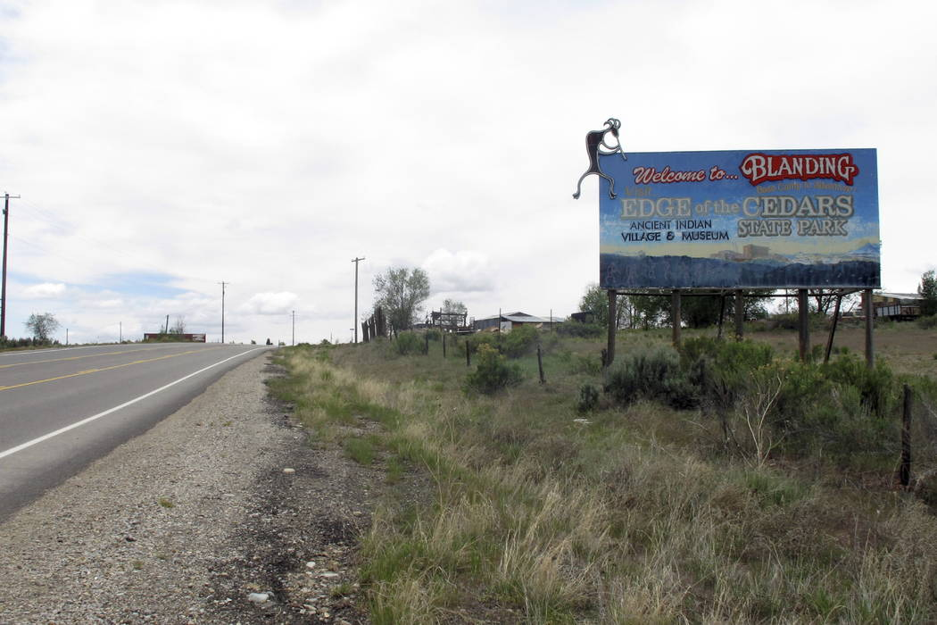 A sign just outside of town welcomes visitors to Blanding, Utah, in May. (Michelle L. Price/Associated Press)