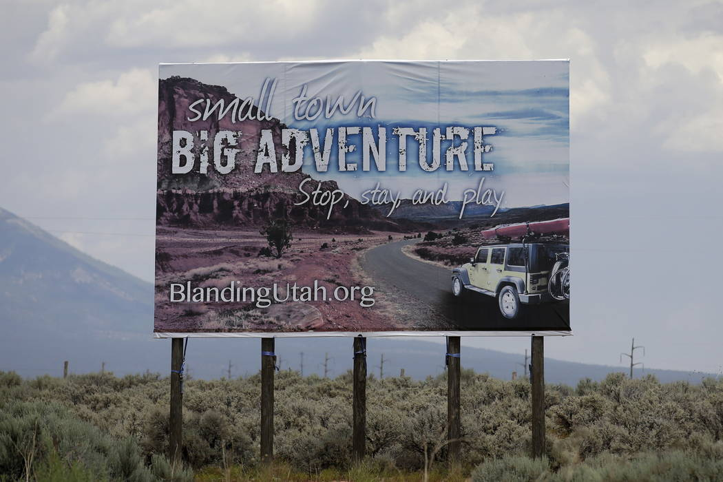 A sign is seen near Blanding, Utah, in 2016. (AP Photo/Rick Bowmer, File)
