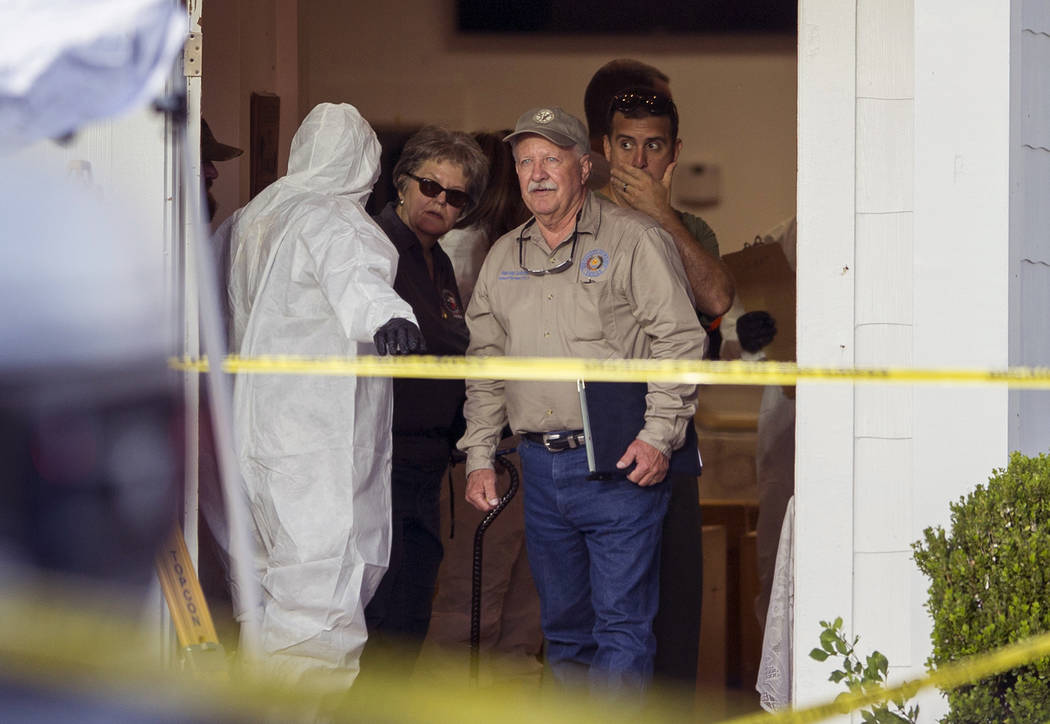 Investigators work at the scene of a mass shooting at the First Baptist Church in Sutherland Springs, Texas,  on Sunday, Nov. 5, 2017. A man opened fire inside of the church in the small South Tex ...