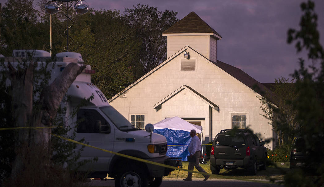 A man walks past the front of the First Baptist Church on Monday, Nov. 6, 2017, where a gunman opened fire on a Sunday service in Sutherland Springs, Texas. (Nick Wagner/Austin American-Statesman  ...