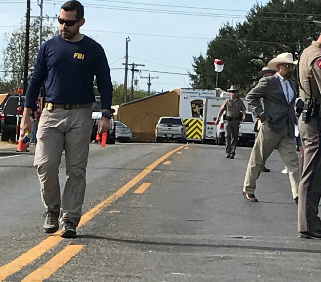 FBI and Texas Department of Public Safety Troopers on the scene in Sutherland Springs Monday. Photo by Gary Martin.