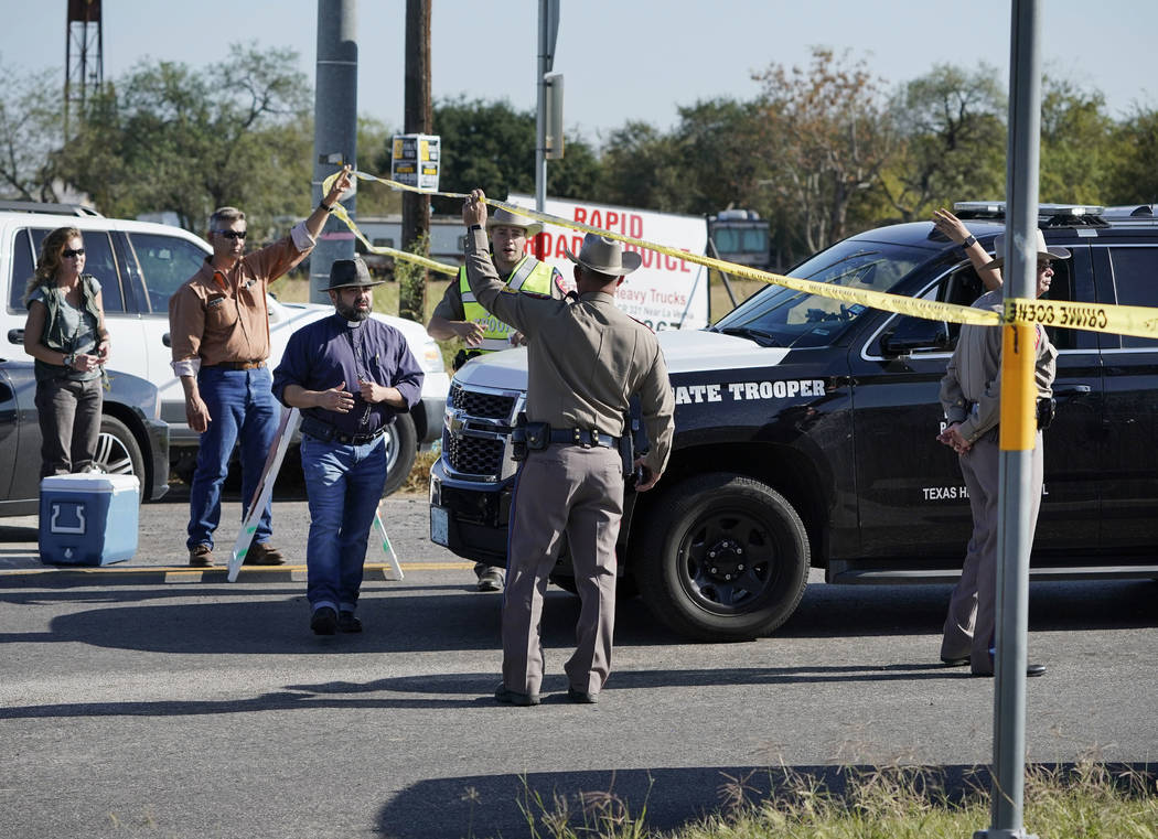Law enforcement officers man a barricade near the First Baptist Church of Sutherland Springs after a fatal shooting, Sunday, Nov. 5, 2017, in Sutherland Springs, Texas. (AP Photo/Darren Abate)