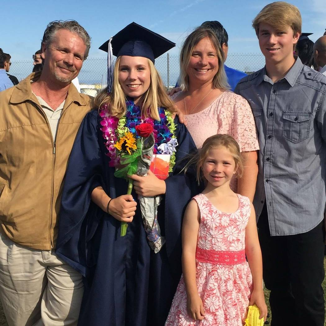 Robert Patterson, left, stands with daughter Amber, wife Lisa, son Robert and daughter Brooke the day Amber, 19, graduated from high school. Lisa was killed in the mass shooting during the Route 9 ...