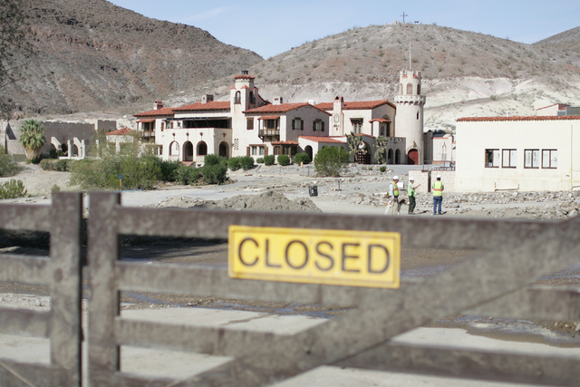 Journalists are taken on a tour of the flood damage at Scotty's Castle in Death Valley National Park on Oct. 24, 2015. The National Park Service will hold limited tours of the still-closed site st ...