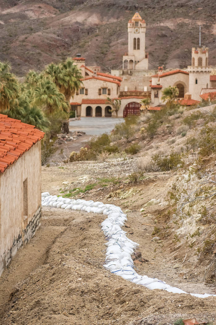 A line of sandbags protects buildings at Scotty's Castle in Death Valley National Park, about 180 miles northwest of Las Vegas. Kurt Moses