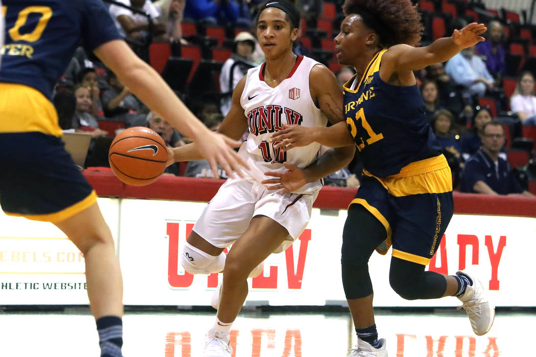 UNLV women's basketball guard Nikki Wheatley (10) tries to drive past between UC Irvine's guards Haleigh Talbert (21) and Andee Ritter (10) during their game at the Cox Pavilion on Tuesday, Nov. 1 ...
