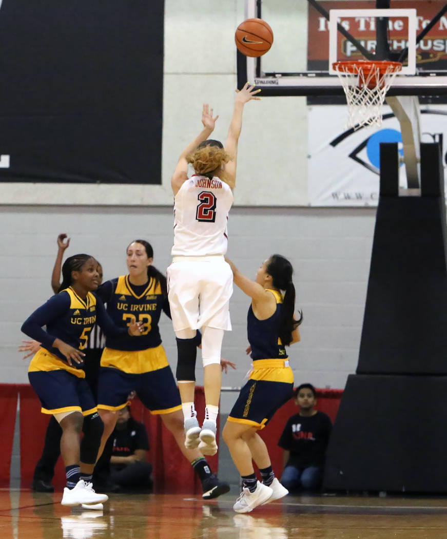 UNLV women's basketball guard Brooke Johnson (2) shoots over UC Irvine's defense during their game at the Cox Pavilion on Tuesday, Nov. 14, 2017, in Las Vegas. UNLV won 73-54. Bizuayehu Tesfaye/La ...