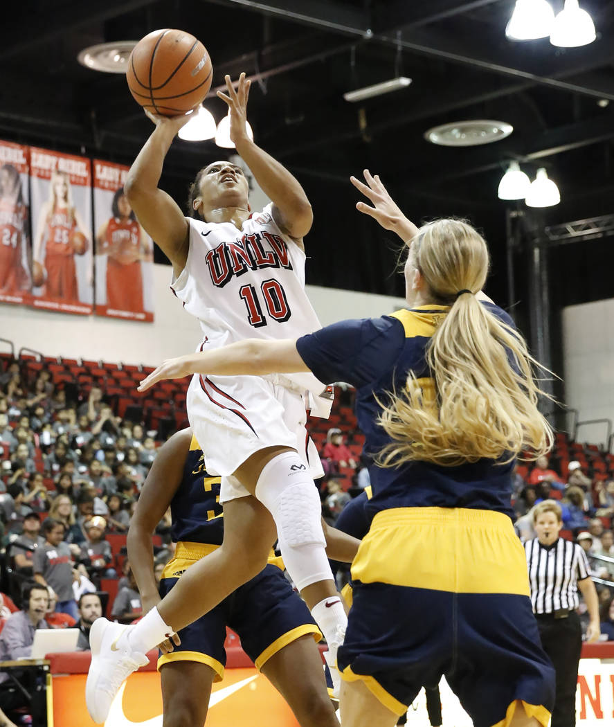 UNLV women's basketball guard Nikki Wheatley (10) shoots over UC Irvine's guard Andee Ritter (10) during their game at the Cox Pavilion on Tuesday, Nov. 14, 2017, in Las Vegas. UNLV won 73-54. Biz ...