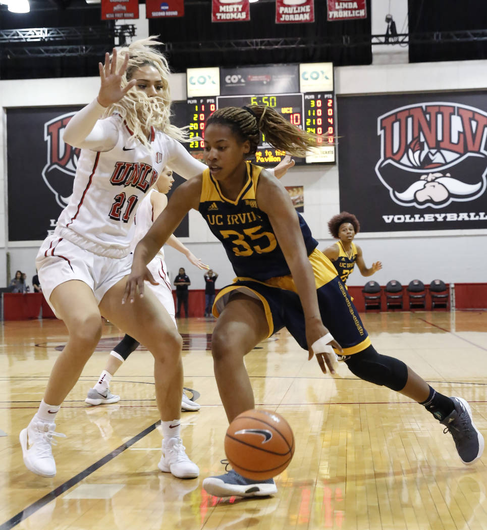 UNLV women's basketball forward/center Katie Powell (23) defends UC Irvine's guard Deijah Blanks (35) during their game at the Cox Pavilion on Tuesday, Nov. 14, 2017, in Las Vegas. UNLV won 73-54. ...