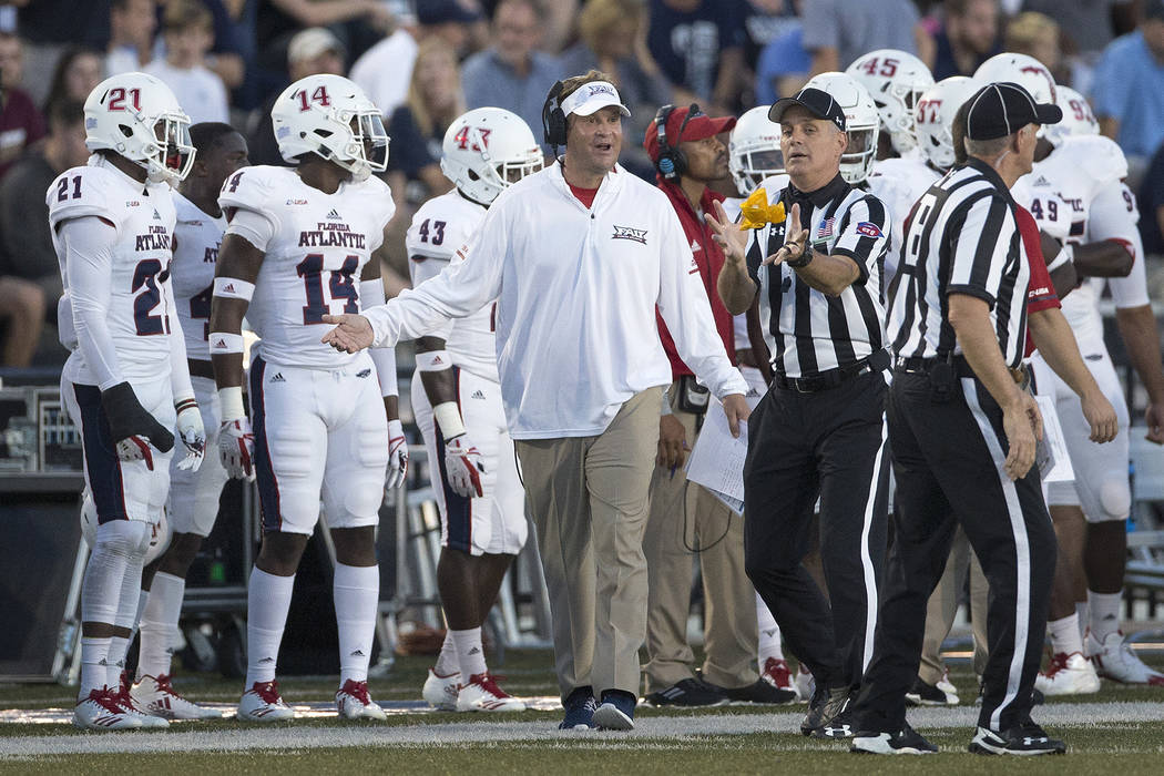 Florida Atlantic head coach Lane Kiffin, center, argues an interference call on the field during the second half of an NCAA college football game against Old Dominion in Blacksburg, Va., Saturday, ...