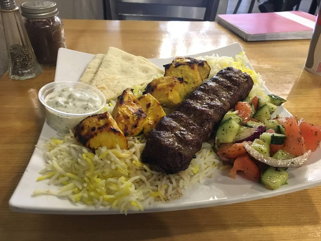 "Flame Kabob's ""mix"", which features a chicken and ground beef skewer on a bed of rice with pita bread and a small serving of vegetables. (Diego Mendoza-Moyers/View) @dmendozamoyers"