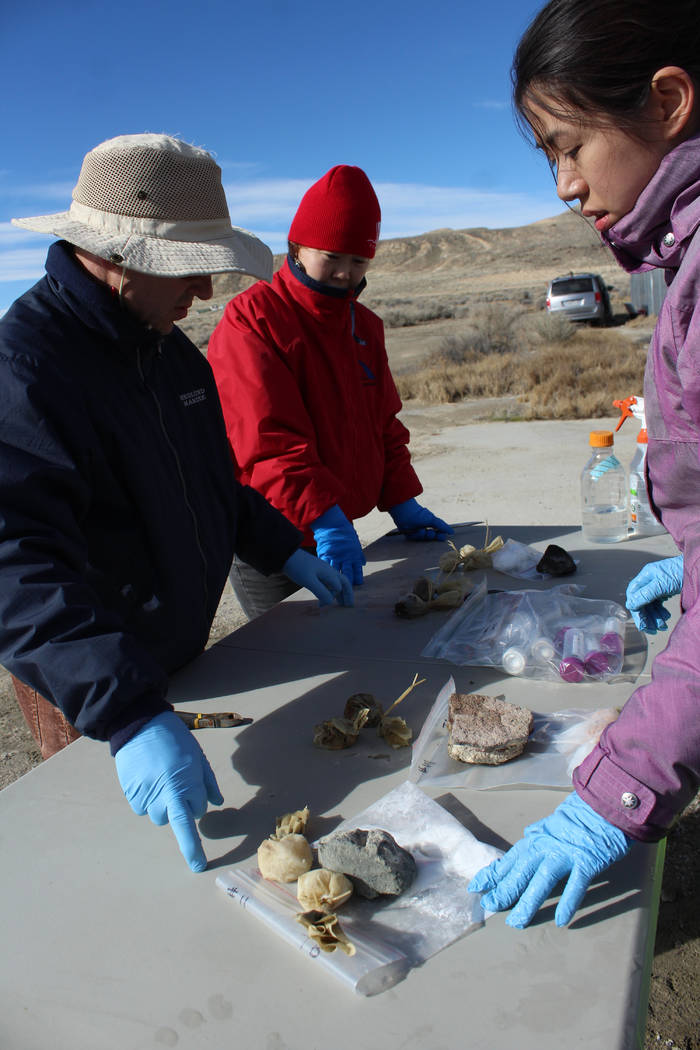 """UNLV researcher Brian Hedlund, visiting Chinese Academy of Sciences professor Li Li and UNLV graduate student Nancy Nou collect """"teabags"""" put into Great Boiling Spring to try to stimulate growth o ..."""