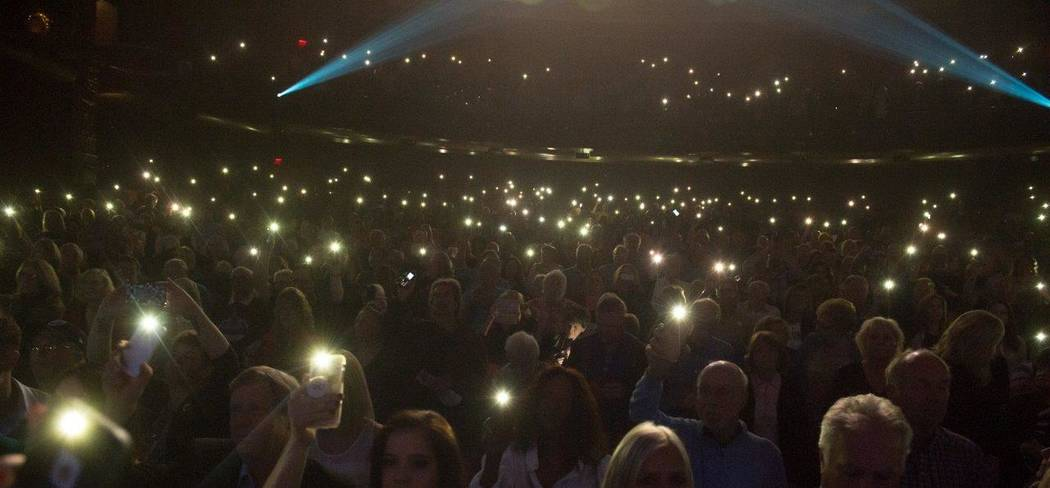 People attending the Vegas Cares show lit up their cellphones in honor of those who were killed in the Oct. 1 mass shooting. (Tom Donoghue)
