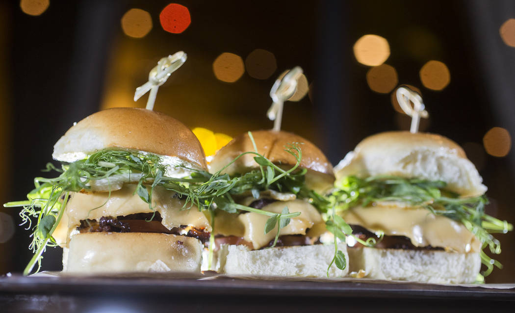 Botequito sliders with ground beef, bacon, smoked gouda, caramelized onions, tomato, quail egg on a brioche bun at Boteco on Wednesday, Nov. 8, 2017, in Las Vegas.  Benjamin Hager Las Vegas Review ...