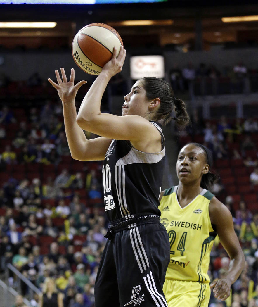 San Antonio Stars' Kelsey Plum, left, shoots in front of Seattle Storm's Jewell Loyd in the first half of a WNBA basketball game Sunday, June 18, 2017, in Seattle. (AP Photo/Elaine Thompson)