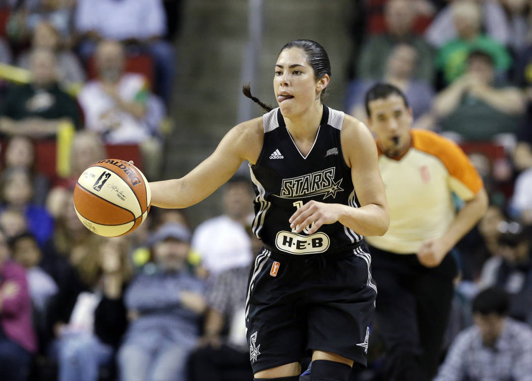 San Antonio Stars' Kelsey Plum in action against the Seattle Storm in a WNBA basketball game Sunday, June 18, 2017, in Seattle. (AP Photo/Elaine Thompson)