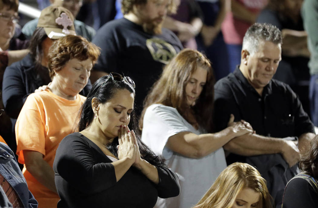 Attendees pray during a vigil for the First Baptist Church shooting victims Tuesday, Nov. 7, 2017, in La Vernia, Texas. A man opened fire inside the church in the small South Texas community on Su ...