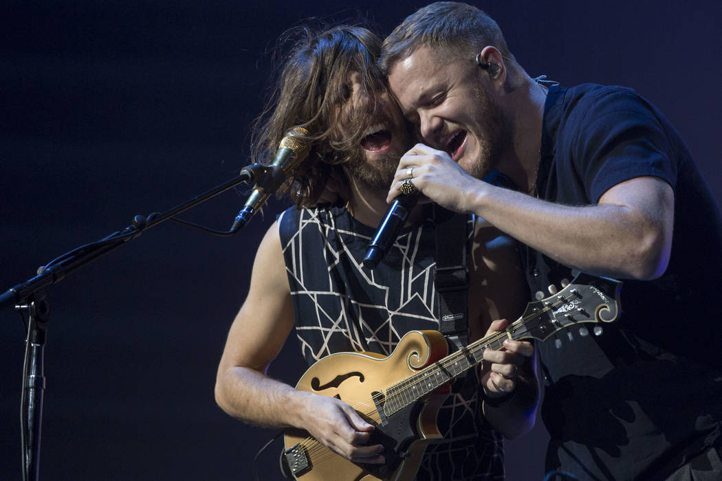 Imagine Dragons guitarist Wayne Sermon, left, and vocalist Dan Reynolds perform during the band's show at T-Mobile Arena in Las Vegas, Friday, Sept. 29, 2017. The show was in part of their Evolve  ...