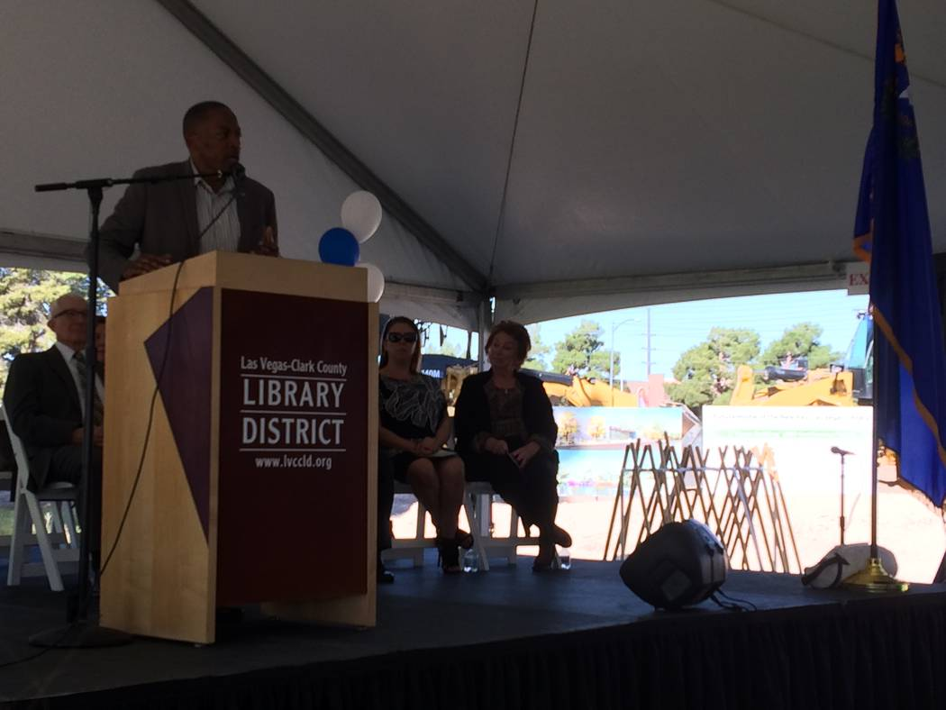 Lawrence Weekly, county commissioner, addresses ground breaking attendees Nov. 2, 2017 at  the lot that will house a new library by spring 2019. In the background, ceremonial shovels await the mom ...