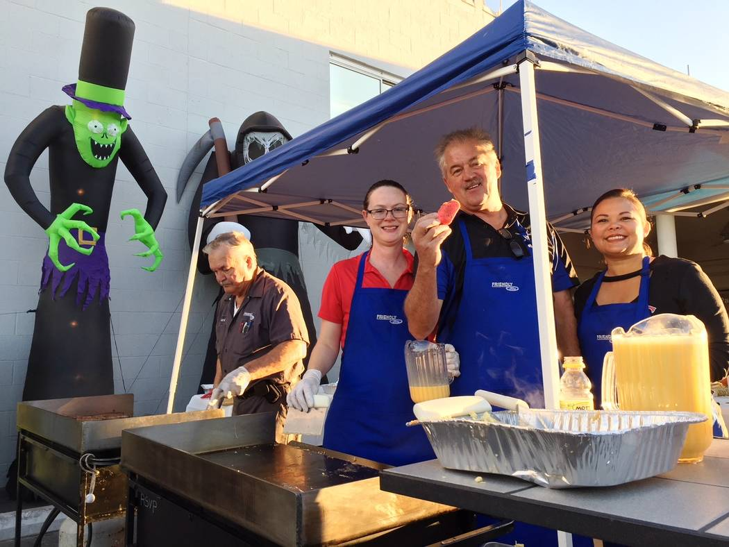 Friendly Ford Friendly Ford's service department recently presented its annual Spooky Tire Halloween breakfast at the dealership at 660 N. Decatur Blvd. From left, Frank Mohr, building maintenan ...