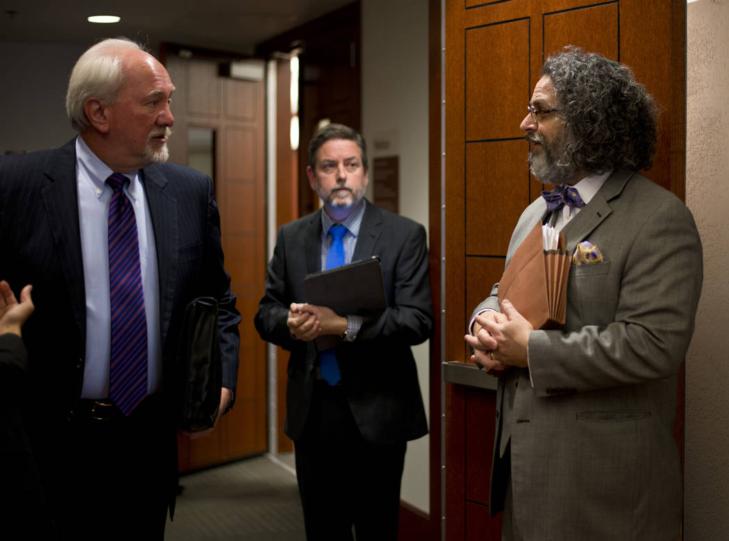 Attorneys Dennis Kennedy, left, and Jacob Hafter converse after court proceedings regarding a lawsuit filed on behalf of a 4-year-old HIV-positive girl seeking to reopen a UNLV based HIV treatment ...